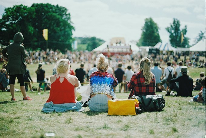 Sitting on grass at festival